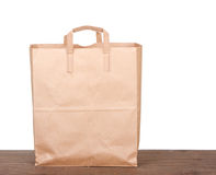 Plain brown paper bag. On white background stock images