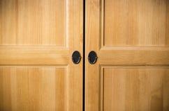 Plain brown wooden doors Stock Image