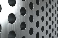 Plain brushed metal surface with cylindrical holes Stock Photos