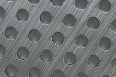 Plain brushed metal surface with cylindrical holes Stock Images