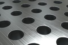 Plain brushed metal surface with cylindrical holes Royalty Free Stock Images