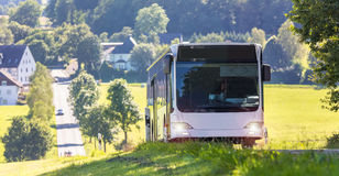 Plain bus on a country road Stock Image