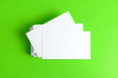 Plain business card. Close up of plain business cards on green background Stock Photos