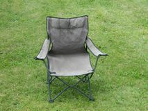 Plain Camping Chair On Open Lawn Royalty Free Stock Images