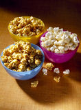 Plain and caramel popcorn Stock Photos