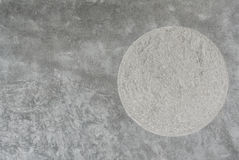 Plain cement wall with round rough texture insert Royalty Free Stock Photos