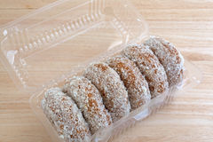 Plain coconut flake donuts in an open container Stock Photo