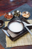 Plain congee with their toppings Stock Photo