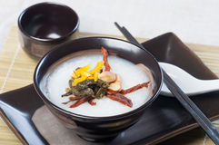 Plain congee with their toppings Stock Images