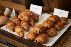 Plain croissant and chocolate puff pastry buns, on restaurant bu stock photos