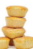 Plain cupcakes. A pile madeleines or plain cupcakes on a white background Royalty Free Stock Photography