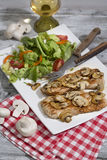 Plain cutlet served with mixed salad and white wine Royalty Free Stock Photography