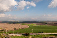 Plain of Esdraelon. The verdant, agricultural Plain of Esdraelon in Israel viewed from the top of Tel Megiddo in Israel.  Some believe the final battle of Royalty Free Stock Image