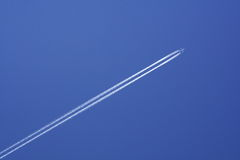 Plain flying in the sky Royalty Free Stock Image