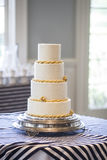 Plain four tiered wedding cake, Royalty Free Stock Images