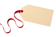 Plain gift tag or manila label with red ribbon isolated on white background Stock Photo