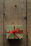 Plain Green Gift Box with Red Ribbon and Vintage Style Christmas Stock Images