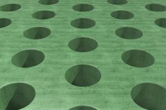 Plain green wooden surface with cylindrical holes Stock Photo