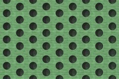 Plain green wooden surface with cylindrical holes Stock Photography