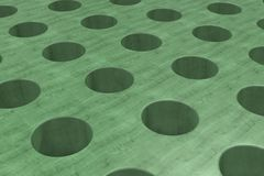 Plain green wooden surface with cylindrical holes Stock Image
