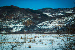 Plain, hills and snow. Royalty Free Stock Photography