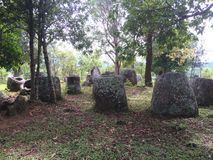 Plain of Jars, Laos. This is one of the sites of the Plain of Jars in Laos, Southeast Asia. Gorgeous area to travel through. amazing how many jars there are Royalty Free Stock Photo