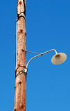 Plain light bulb on a wooden lamp post.  Royalty Free Stock Photography