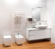 Plain monochromatic white bathroom Royalty Free Stock Image