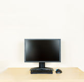Plain office desk with monitor Royalty Free Stock Photo