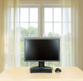Plain office desk with monitor with window Royalty Free Stock Images