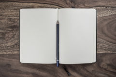 Plain. Open plain white notebook with pencil on dark wood desk Stock Images