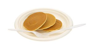 Plain pancakes on paper plate Stock Photos