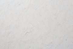 Plain paper background. Plain light gray textured paper background with few dirty marks stock images