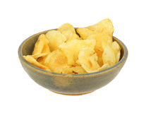 Plain potato chips in an old bowl Stock Image