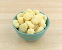 Plain potato gnocchi in a green bowl Stock Photography