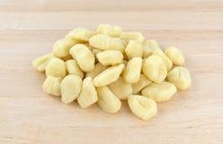 Plain potato gnocchi on a wood counter top Stock Photos