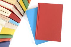 Plain red book, blank, top view, with row of colorful books Stock Image
