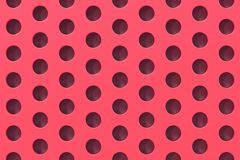 Plain red surface with cylindrical holes Stock Image