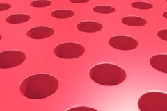 Plain red surface with cylindrical holes Royalty Free Stock Photo