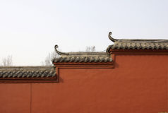 Plain Red Wall. With Chinese Style Roof Stock Photo