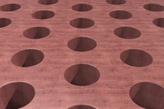 Plain red wooden surface with cylindrical holes Stock Image