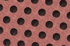Plain red wooden surface with cylindrical holes Stock Photo