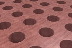 Plain red wooden surface with cylindrical holes Stock Photography