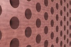 Plain red wooden surface with cylindrical holes Stock Photos