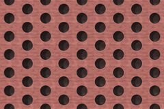 Plain red wooden surface with cylindrical holes Royalty Free Stock Photography
