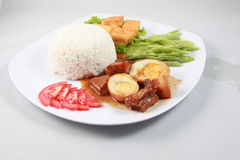 Plain rice with braised pork with egg in Vietnam Stock Photo