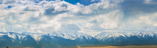 Plain at root of mountains Royalty Free Stock Photos