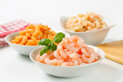 Plain and seasoned shrimps Royalty Free Stock Photos