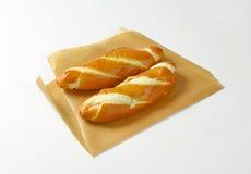 Plain soft long white rolls Stock Images