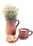 Plain still life with milk, cakes and chamomiles Royalty Free Stock Image